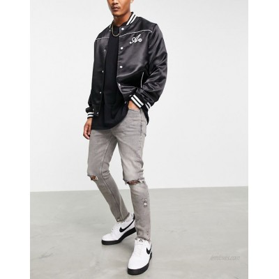 DESIGN skinny jeans with rips and raw hem in washed grey