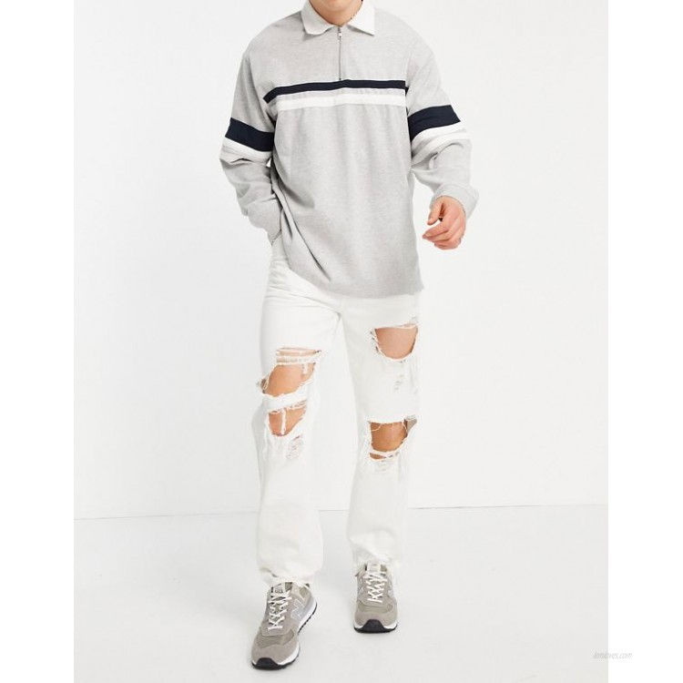 DESIGN dad fit jeans in white with heavy rips