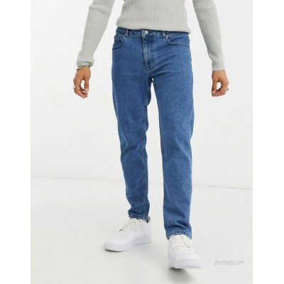 DESIGN stretch tapered jeans in retro mid wash blue
