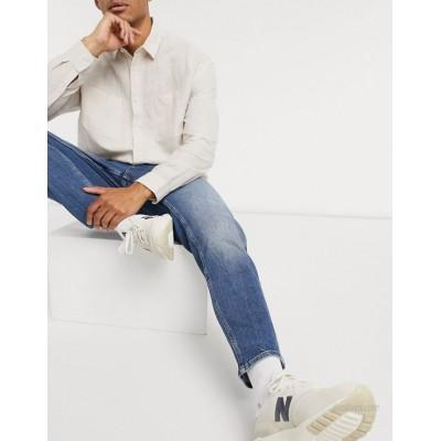 DESIGN stretch tapered jeans in vintage dark wash blue