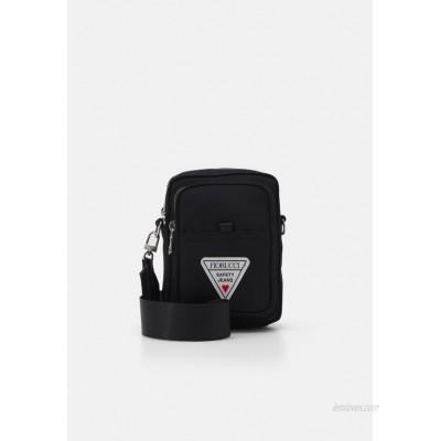 Fiorucci CROSS BODY BAG UNISEX - Across body bag - black